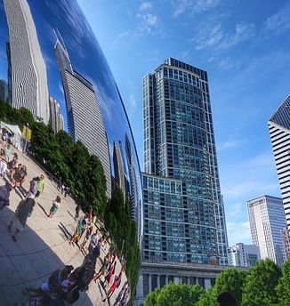 Image of Chicago's VCloud Gate sculpture buildings and surrounding buildings.