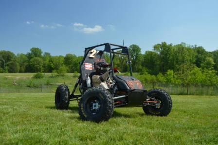 A buggy that utilized Binsfeld's torque monitoring devices prepares to compete in the SAE Baja competition.
