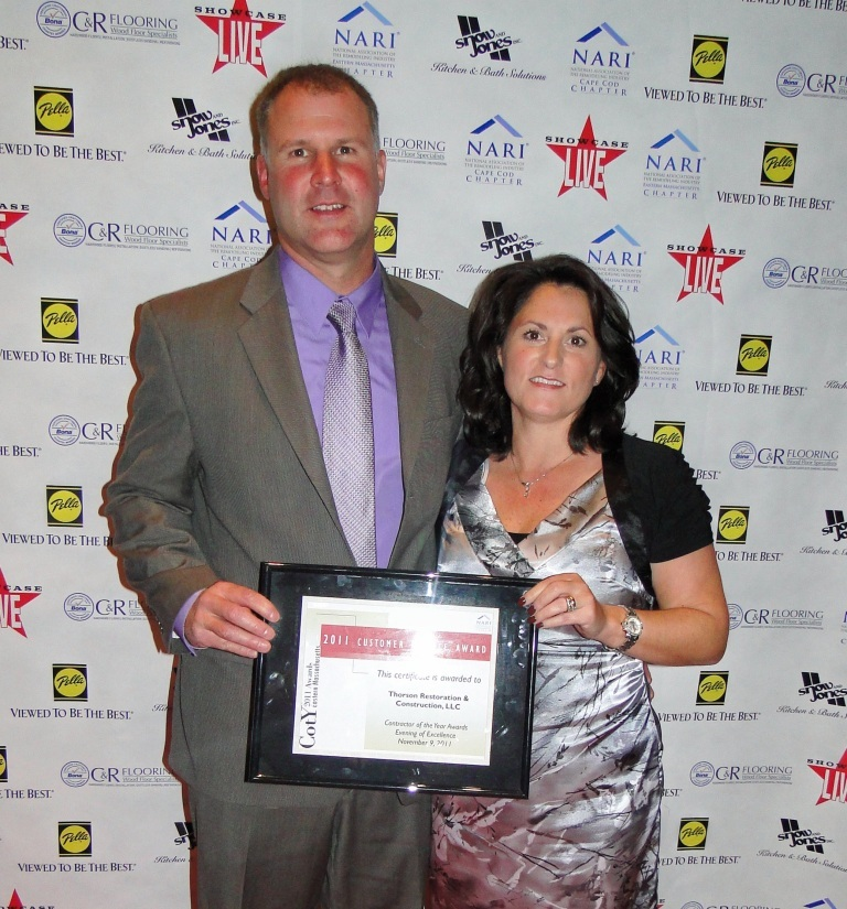 Eric & Stacy with Customer service Award