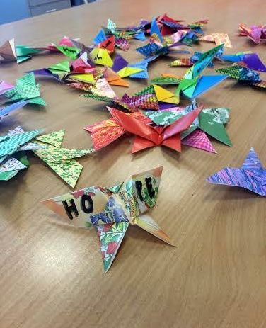 Origami butterflies made by students at Harmony